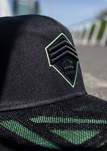 Green logo cap Hassing1894